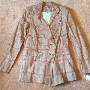 Really cute plaid button blazer.